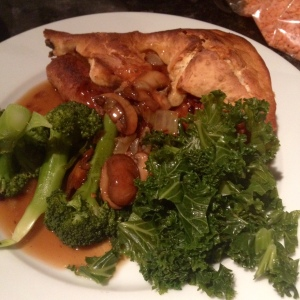 Vegan Toad in the Hole in all her plated up glory. Served with mushroom gravy, kale and broccoli